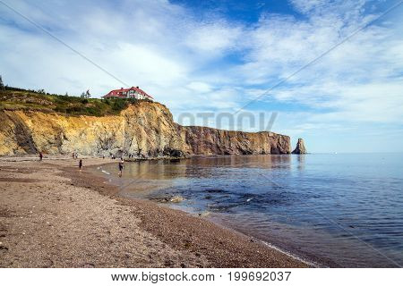 Perce Canada-11 August 2017 : View of Perce Rock at summer. Perce Rock is a huge sheer rock formation in the Gulf of Saint Lawrence on the tip of the Gaspe Peninsula in Quebec Canada off Perce Bay.