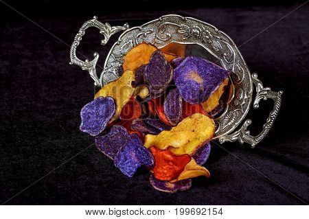 Crunchy Appetizer Of Potato Chips Made From Crimson Red, Purple