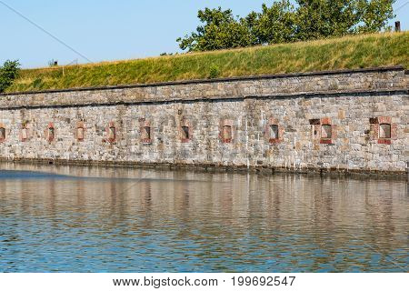 HAMPTON, VIRGINIA - JULY 9, 2017:  Fortress walls at Fort Monroe surrounded by a moat.  Construction began on Fort Monroe in 1819 as part of a coastal defense strategy developed by the U.S. Army.