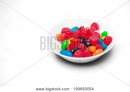 bowl of colorful candy on a white background