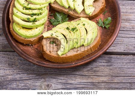 Healthy sandwich with bread and avocado .