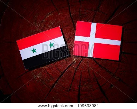 Syrian Flag With Danish Flag On A Tree Stump Isolated