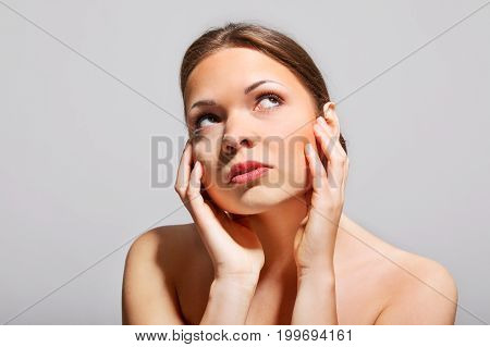 The portrait of beautiful young woman. Perfect face. Spa concept.