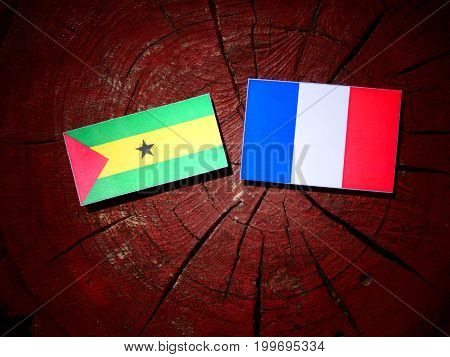 Sao Tome And Principe Flag With French Flag On A Tree Stump Isolated
