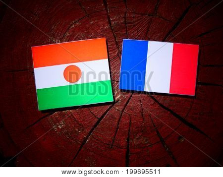 Niger Flag With French Flag On A Tree Stump Isolated
