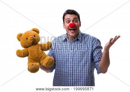 Funny clown man with a soft teddy bear toy isolated on white bac