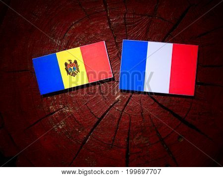 Moldovan Flag With French Flag On A Tree Stump Isolated