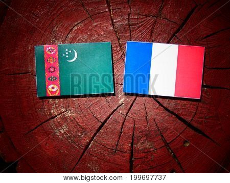 Turkmenistan Flag With French Flag On A Tree Stump Isolated