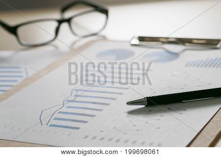 Checking Financial Reports Paperwork And Business  Teamwork On Preparing Report Blue Graphs  Glasses