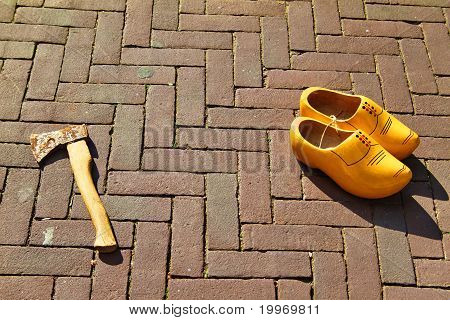 Dutch Wooden Shoes On The Street With A Hammer