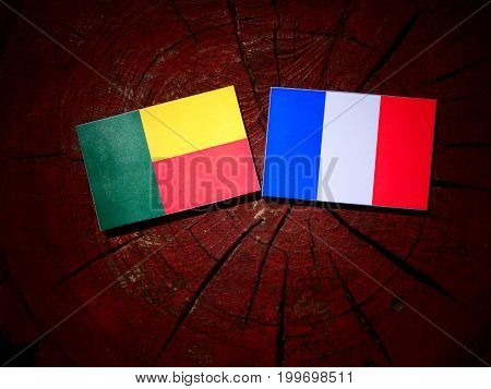 Benin Flag With French Flag On A Tree Stump Isolated
