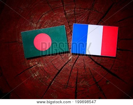 Bangladesh Flag With French Flag On A Tree Stump Isolated