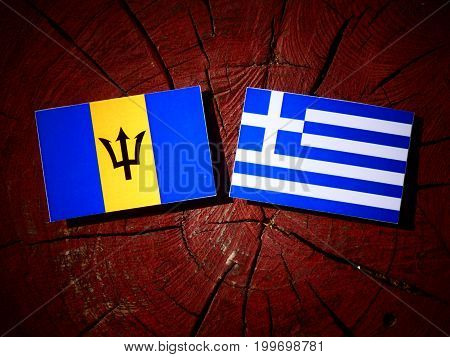 Barbados Flag With Greek Flag On A Tree Stump Isolated