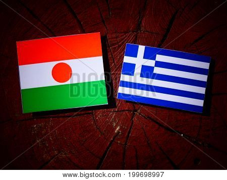Niger Flag With Greek Flag On A Tree Stump Isolated