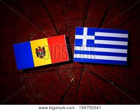 Moldovan Flag With Greek Flag On A Tree Stump Isolated