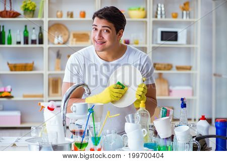 Man enjoying dish washing chores at home