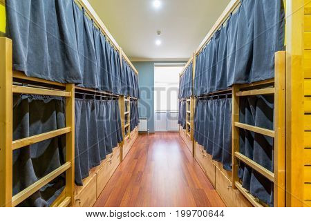 Hostel dormitory beds arranged in room