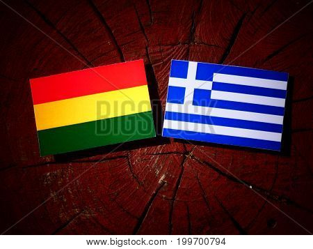 Benin Flag With Greek Flag On A Tree Stump Isolated