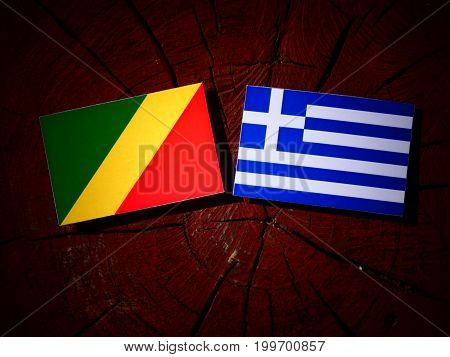 Republic Of The Congo Flag With Greek Flag On A Tree Stump Isolated