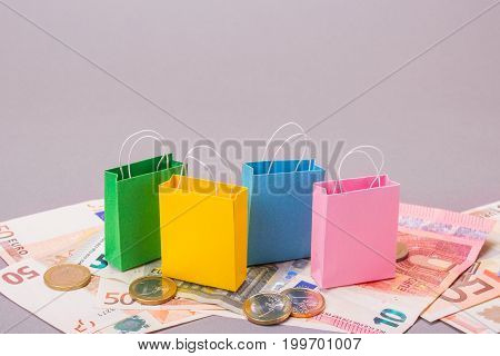 Color packs for purchases and dengi euro on a gray background. Copy space for text