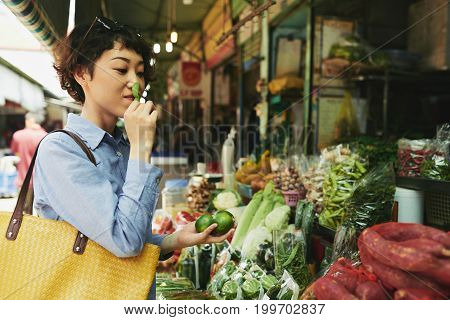 Japanese pretty woman shopping for groceries at market