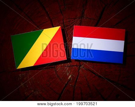 Republic Of The Congo Flag With Dutch Flag On A Tree Stump Isolated