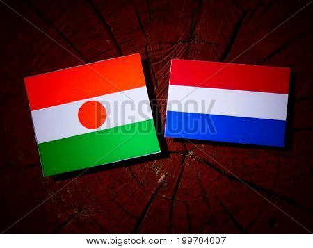 Niger Flag With Dutch Flag On A Tree Stump Isolated