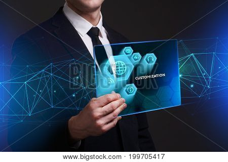 Business Technology Internet and network concept. Young businessman working on a virtual screen of the future and sees the inscription: Customization