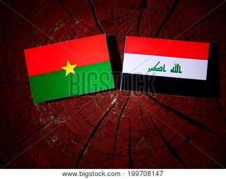 Burkina Faso Flag With Iraqi Flag On A Tree Stump Isolated