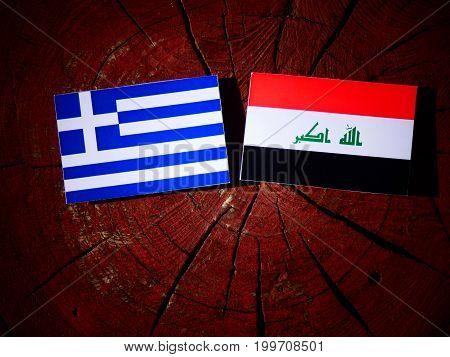 Greek Flag With Iraqi Flag On A Tree Stump Isolated