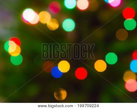 Beautiful rainbow background with blurred bokeh. Merry christmas. Multi-colored confetti.