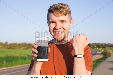 Activity tracker on a man's wrist on the street