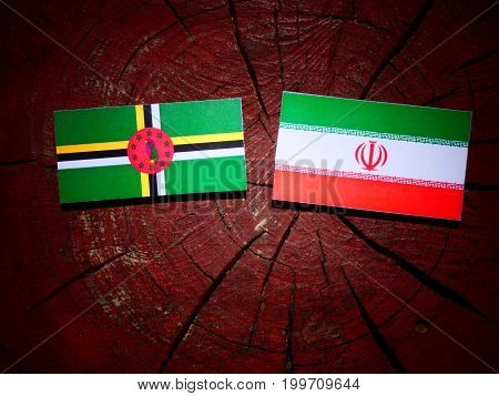 Dominica Flag With Iranian Flag On A Tree Stump Isolated