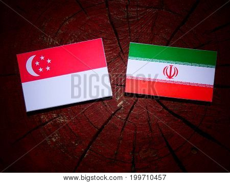 Singaporean Flag With Iranian Flag On A Tree Stump Isolated