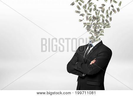 A businessman with forded hands and many dollar bills flying out in place of his head. Profit-oriented person. Money-making. Banking and investment.