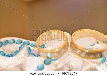 Wedding accessories details. Wedding rings on bride garter
