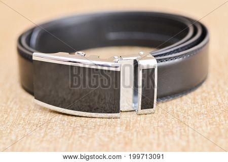 wedding accessories details. groom black leather belt
