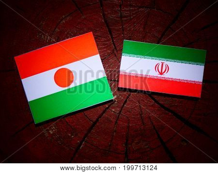 Niger Flag With Iranian Flag On A Tree Stump Isolated