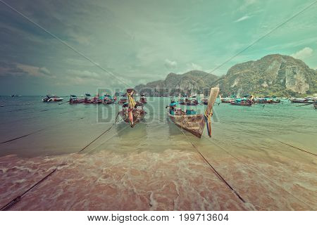 PHI PHI ISLAND, THAILAND. July 27, 2017: Shore with characteristic boats at Phi Phi Island in Thailand.