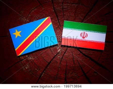Democratic Republic Of The Congo Flag With Iranian Flag On A Tree Stump Isolated