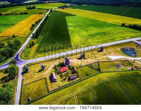 Saarema Island, Estonia: beautiful aerial top view of summer fields and Angla windmills in Leisi Parish