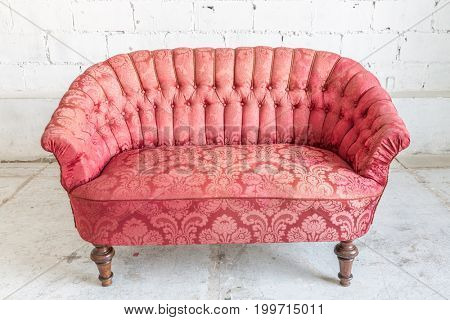 Red sofa couch in vintage room - classical style