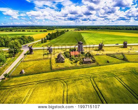 Saarema Island, Estonia: beautiful aerial top view of summer fields and Angla windmills in Leisi Parish
