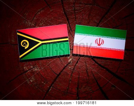 Vanuatu Flag With Iranian Flag On A Tree Stump Isolated