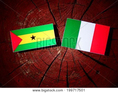 Sao Tome And Principe Flag With Italian Flag On A Tree Stump Isolated