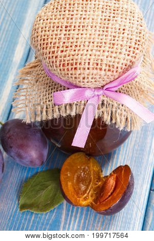 Fresh Plum Marmalade In Jar And Ripe Fruits On Boards, Healthy Sweet Dessert