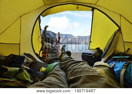 Traveler Lying Down In The Tent With Segara Anak Lake View