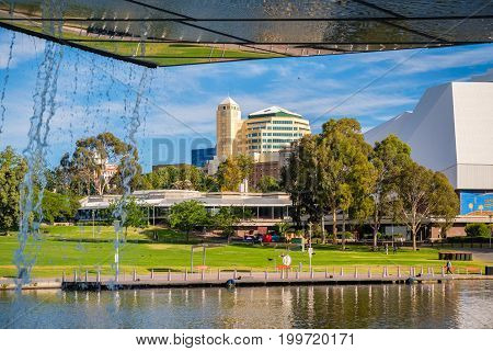 Adelaide Australia - December 2 2016: Adelaide city centre viewed from under the foot bridge in Elder Park on a bright day