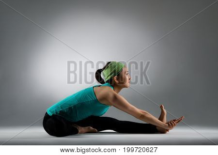 Beautiful Fitness Woman Sitting On The Clean Floor