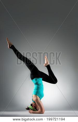Pretty Yoga Fitness Coach Woman  Stretching Legs